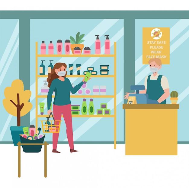 Een vrouw die lichaamsverzorgingsproducten koopt bij lichaamsverzorgingswinkel terwijl ze afstand houdt met anderen