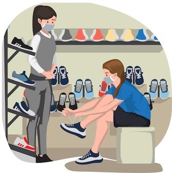 Een vrouw die nieuwe schoenen probeert bij schoenenwinkel