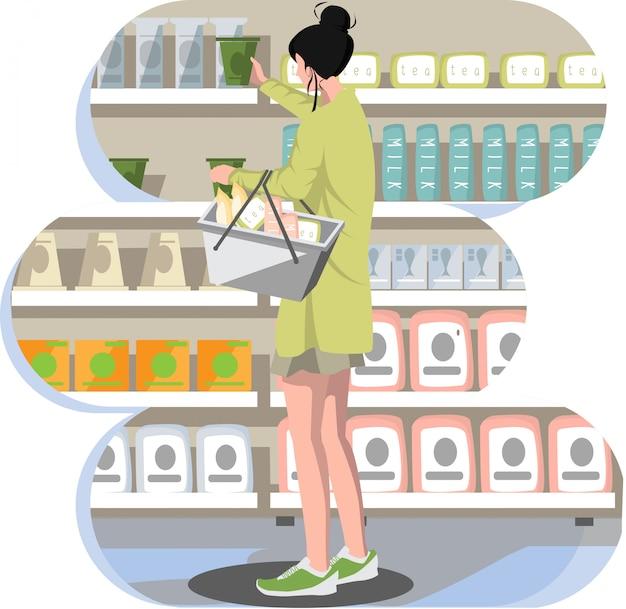 Een vrouw die producten kiest bij kruidenierswinkel
