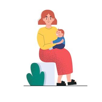 Een vrouw die zit en een kleine baby vasthoudt. een moeder en zoontje.