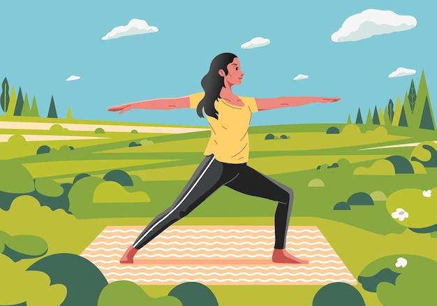 Een vrouw doet yoga oefeningen in de buitenlucht met behulp van yoga mat en prachtig landschap Premium Vector
