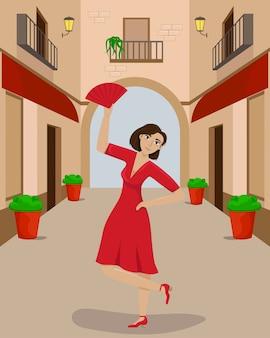Een vrouw in een rode jurk in een dans pose op een smal europees straatje.