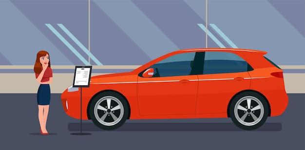 Een vrouw kiest een auto bij een autodealer.