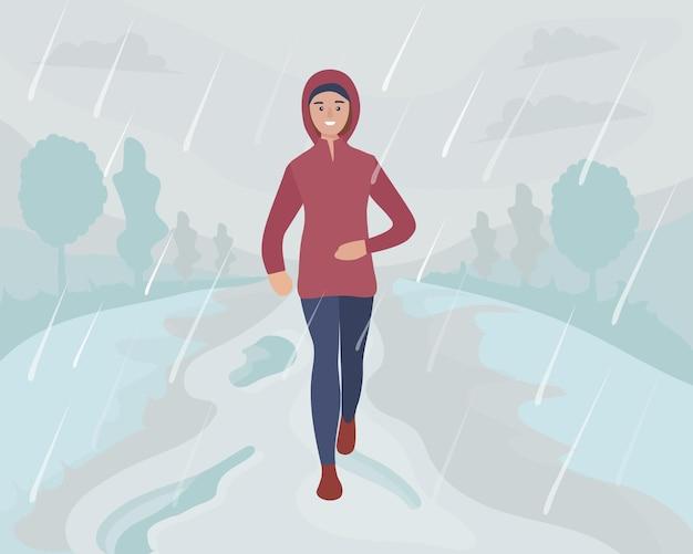 Een vrouw loopt in het park in de regen en sneeuw. sporttraining op straat. loper in beweging. marathon en lange runs buiten. elke dag hardlopen en fitnessen in alle weersomstandigheden. comfortabele sportkleding