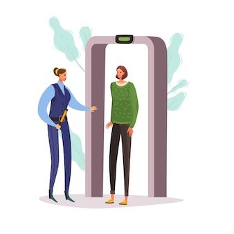 Een vrouw passeert een metaaldetector. check point op de luchthaven.