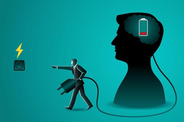 Een zakenman die een stekker draagt om een brein op te laden
