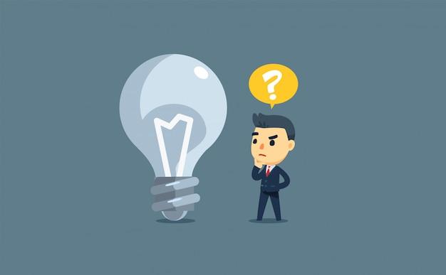Een zakenman en een dode lamp