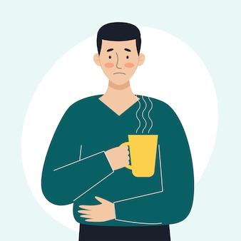 Een zieke man houdt een mok met een warme medicinale drank in zijn hand het concept van zieke mensen