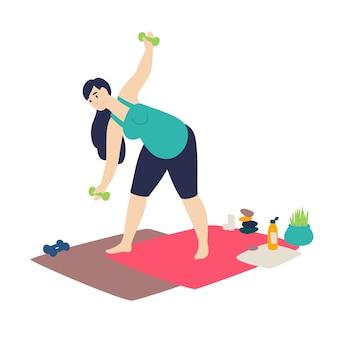 Een zwangere vrouw die gymnastiek doet