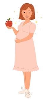 Een zwangere vrouw houdt een appel in haar hand