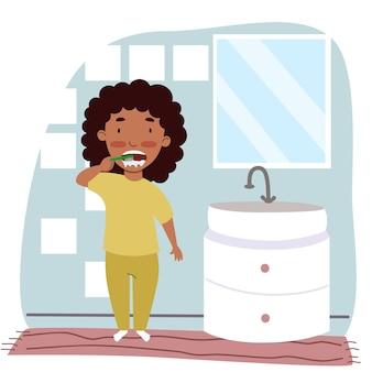 Een zwart meisje in pyjama poetst haar tanden in de badkamer. kinderen zijn hygiëne. een kind met een tandenborstel. vectorillustratie in een vlakke stijl.