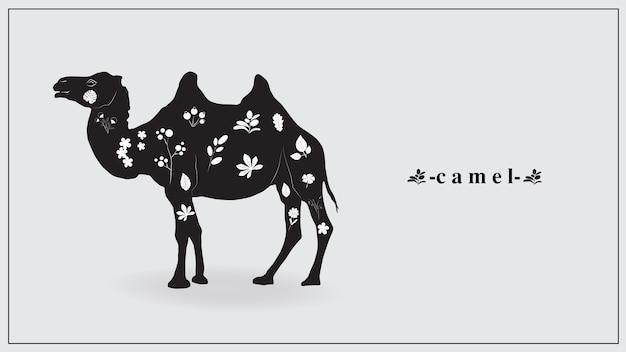 Een zwarte kameel met witte bloemen en planten.