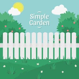 Eenvoudige tuin scène met een witte hek