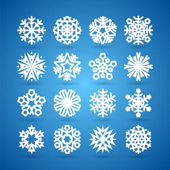 Eenvoudige vlakke sneeuwvlokken instellen voor winter en kerstmis desing