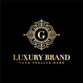 Eerste g brief luxe vintage schoonheid bloeien ornament gouden monogram logo