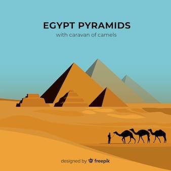 Egypte achtergrond met piramides en kamelen