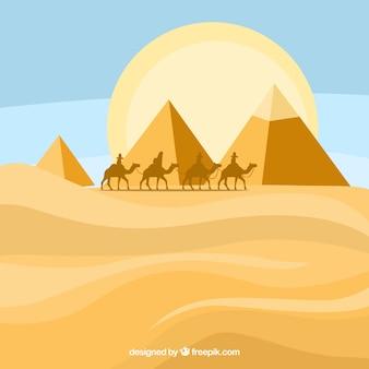 Egyptisch piramideslandschap met caravan van kamelen