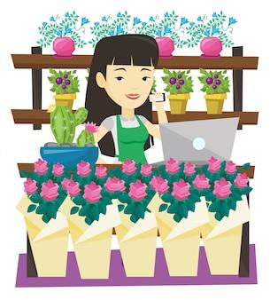 Eigenaar van bloemenwinkel praten over een telefoon.