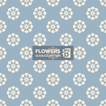 Eigentijds bloemenvorm naadloos patroon op lichtblauw