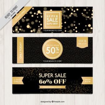 Elegante donkere banners met gouden details