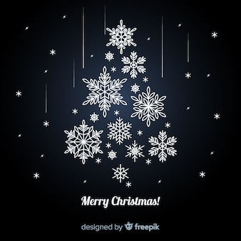 Elegante kerstboomachtergrond die van ornamenten wordt gemaakt