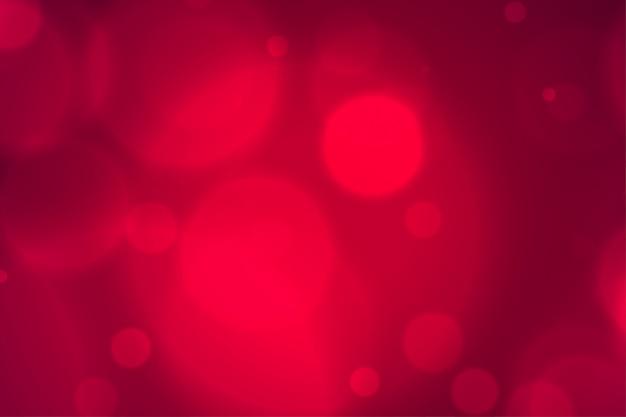 Elegante onscherpe rode bokeh steekt achtergrond aan