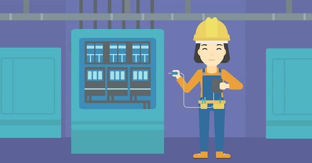 Elektricien met elektrische apparatuur.