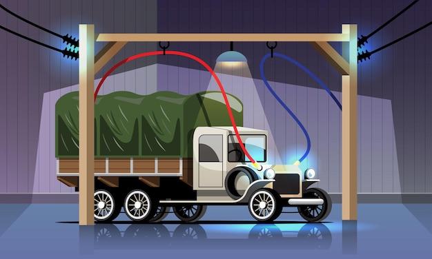 Elektrische vrachtwagen in oude stijl wordt opgeladen in de krachtcentrale van de garage