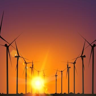 Elektrische windmolengeneratoren tijdens zonsondergang.