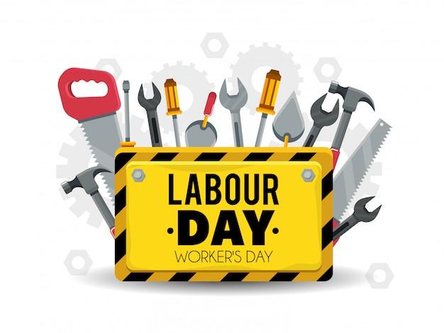 Embleem met bouwhulpmiddelen om arbeidsdag te vieren