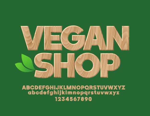 Embleem met tekst vegan shop houten getextureerde lettertype bio boompatroon alfabetletters en cijfers