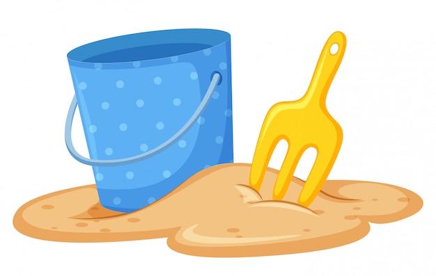Emmer en schop in zand