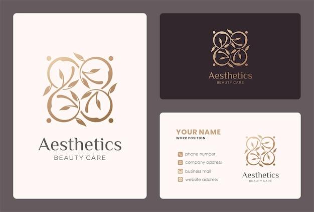 Esthetisch logo met bladtakelement en visitekaartjeontwerp.