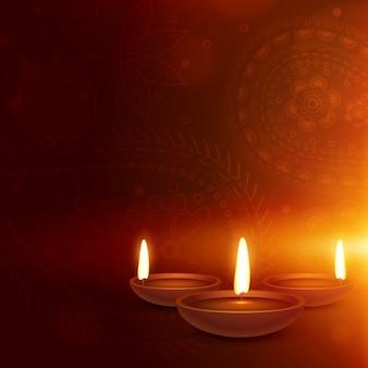 Etnische paisley achtergrond met drie diya diwali groet