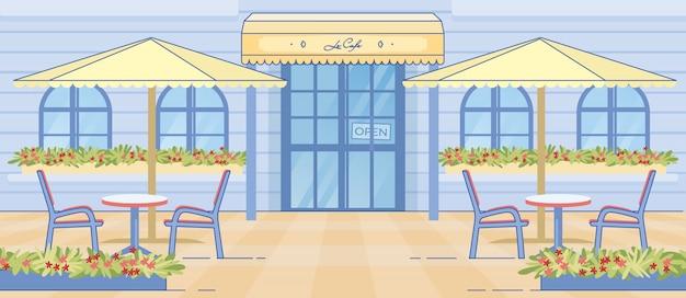 Europese cafe deur tafel en stoelen onder paraplu
