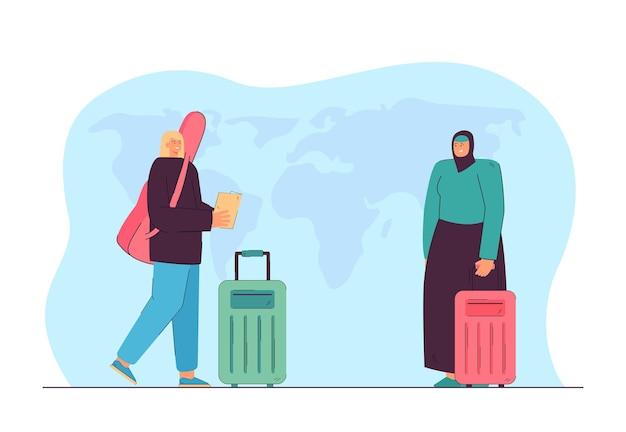 Europese en arabische vrouwelijke reizigers met bagage