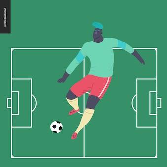 Europese voetbalvoetballer die een voetbalbal schoppen op groen voetbalgebied