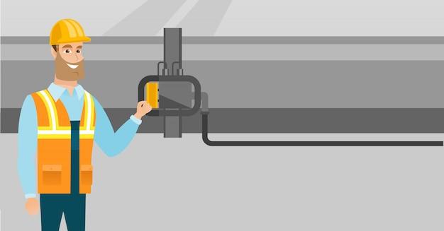 Exploitant die detector op gaspijpleiding controleert.