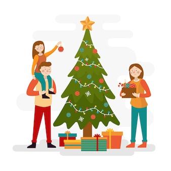 Familie die de achtergrond van de kerstboomwintertijd verfraait