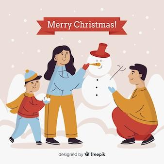 Familie die de kerstmisachtergrond van kerstmis van de sneeuwmankerstboom bouwen