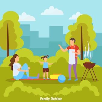Familie die een barbecue doet bij het park