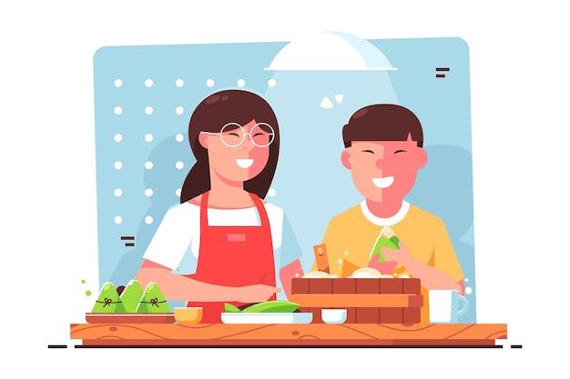Familie die en zongzi thuis voorbereiden eten