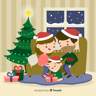 Familie die kerstmisachtergrond deelt