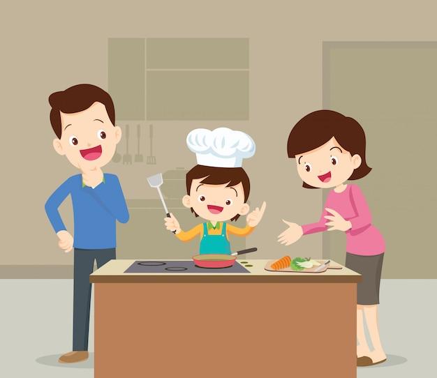 Familie en zoon koken