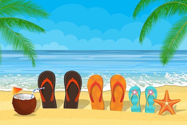 Familie flip-flops op het strand met de zee
