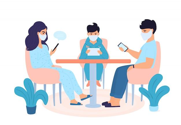 Familie in quarantaine geplaatst. zelfisolatie. coronapandemie. het concept van thuis blijven. de mens gebruikt gadgets. vrouw is online chatten op smartphone. een jongen speelt een computerspel op een tablet.