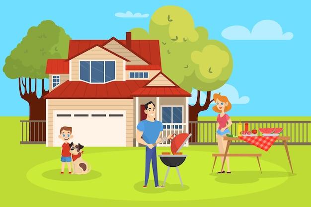 Familie op bbq-feest in de achtertuin