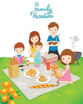 Familie picknick in openbaar park, fijne vakantie, gezinsactiviteiten
