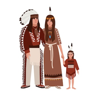 Familie van amerikaanse indianen. moeder, vader en dochter gekleed in etnische tribale kleding die bij elkaar staan