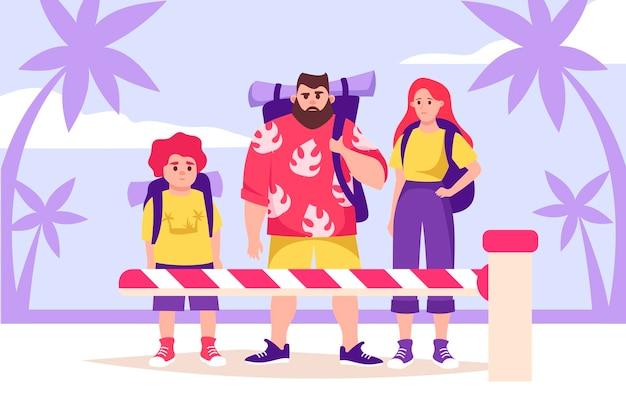 Familie van toeristen achter de slagboom